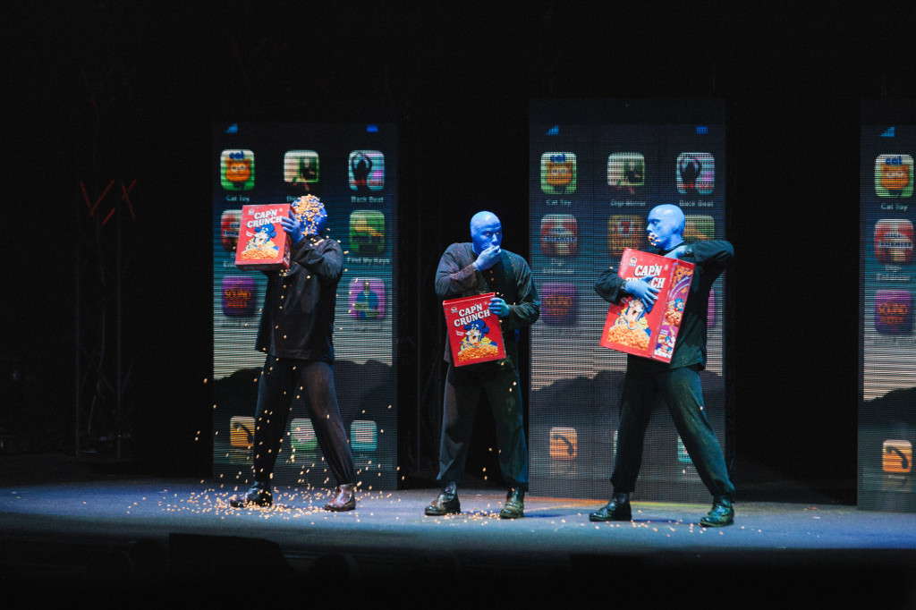 The Blue Men comically devouring the cereal. |Cam Peters