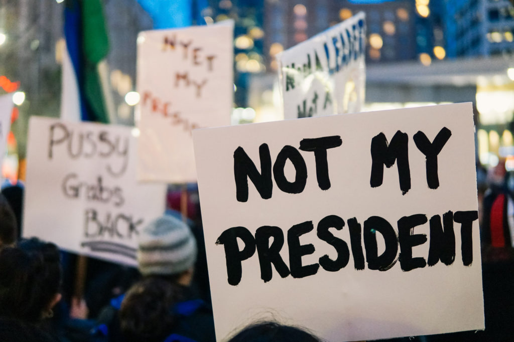 Signs at the march on Friday decried the newly inaugurated president.