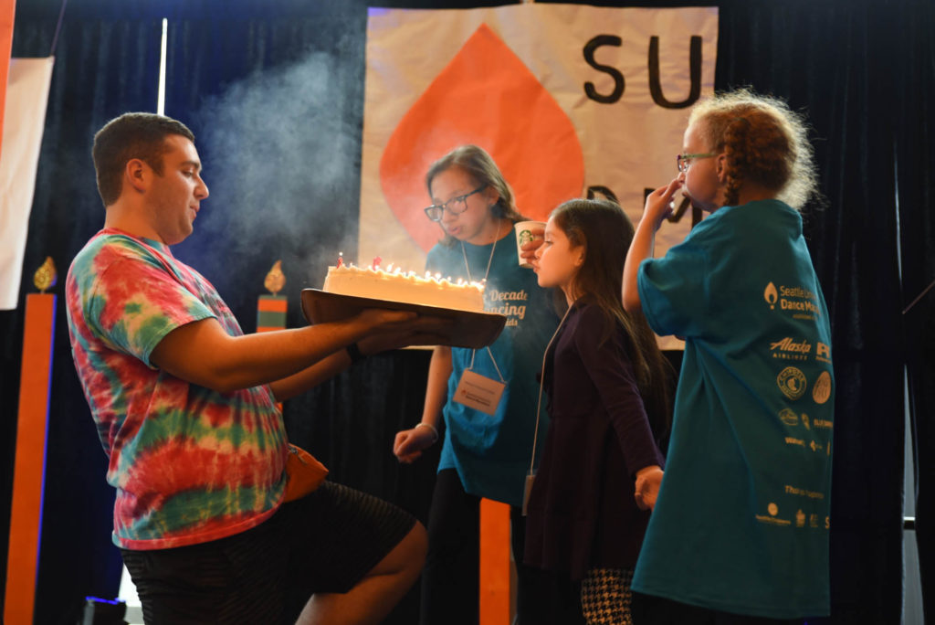 Miracle Children blowing out the Birthday cake for SUDM's 10th birthday.