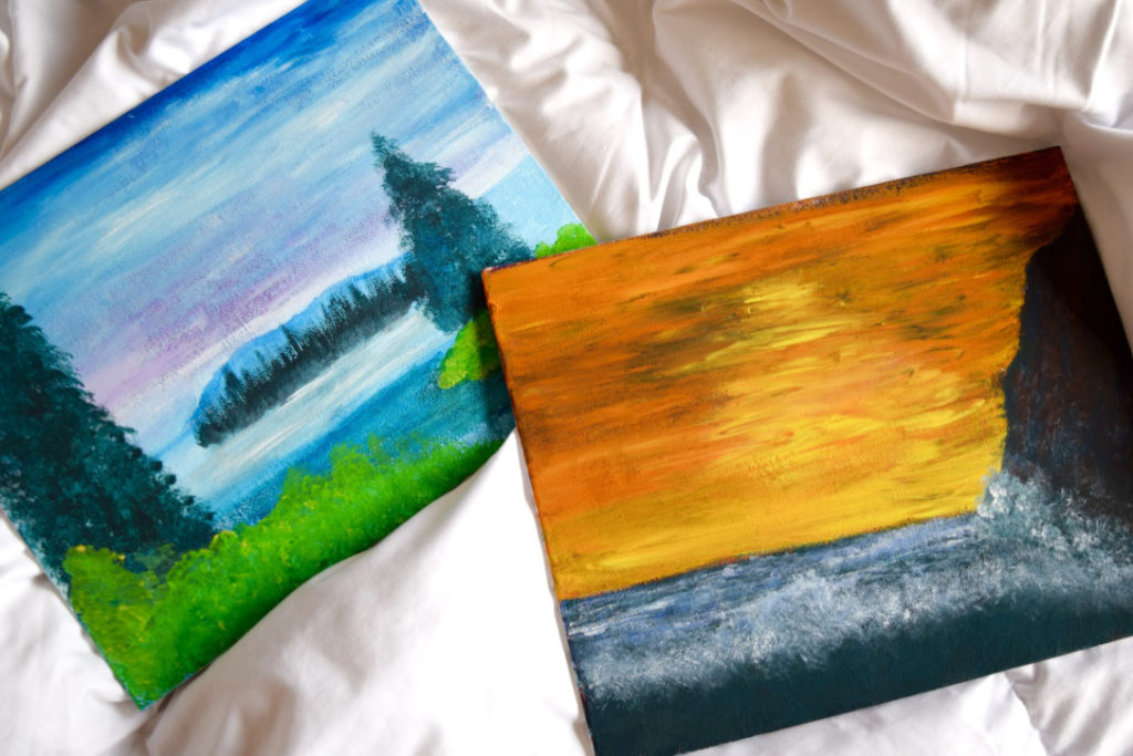 Two finished paintings from the Bob Ross painting night.