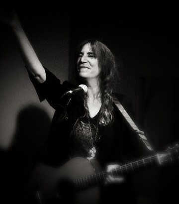 Patti Smith in concert. Photo by August Brill via Flickr Creative Commons.