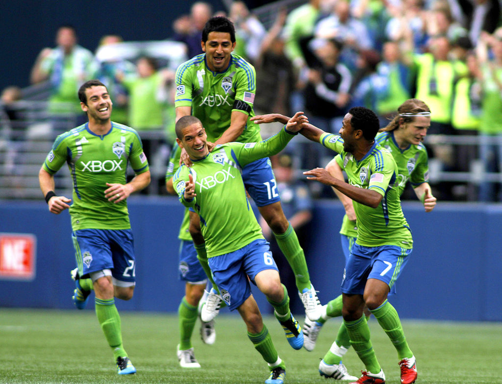 The Sounders celebrating during brighter times. • PHOTO VIA SUZANNE TENNANT, CAL SPORT MEDIA
